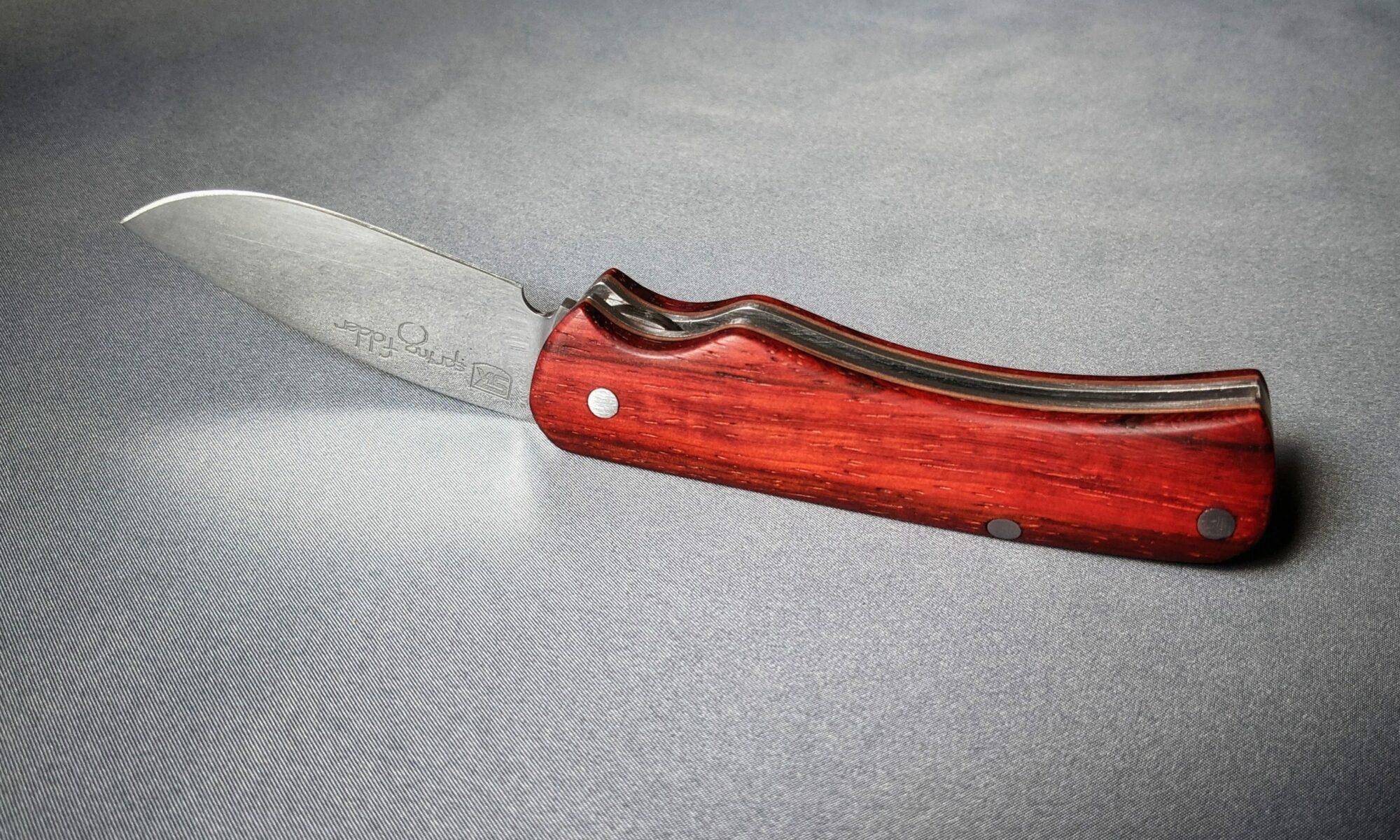 Spring folder knife header image with padouk handle scales